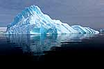 Iceberg reflected in dark calm water