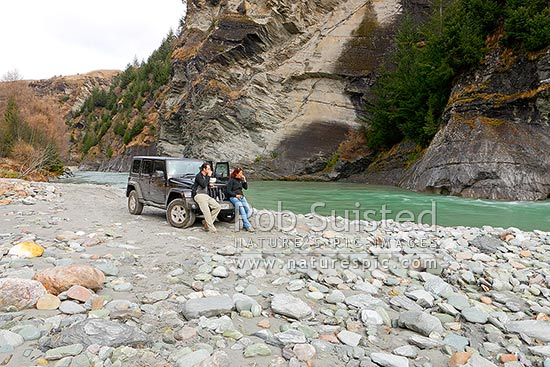 Shotover River stop with four wheel drive. Skippers Road lunch picnic with Jeep by River, Queenstown, Queenstown Lakes District, Otago Region, New Zealand (NZ) stock photo.