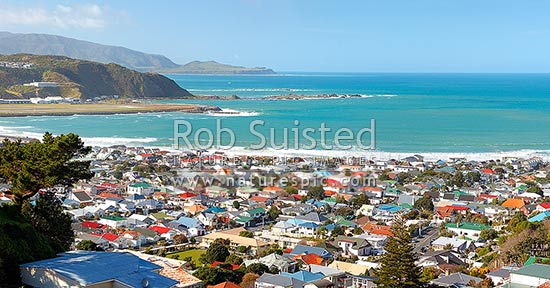 Wellington South Coast panorama, Lyall Bay suburb and houses, Moa Point, with fishing boat leaving harbour entrance, Pencarrow Head and Cook Strait beyond, Wellington South Coast, Wellington City District, Wellington Region, New Zealand (NZ) stock photo.