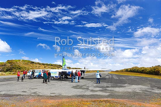 Stewart Island airport (airstrip) with Stewart Island Flights Britten-Norman Islander and passengers, Halfmoon Bay, Oban, Stewart Island District, Southland Region, New Zealand (NZ) stock photo.