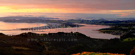 Omaha Beach and Whangateau Harbour, with Kawau Island far left. Sunrise. Panorama, Leigh, Rodney District, Auckland Region, New Zealand (NZ) stock photo.