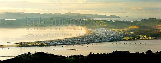 Omaha Beach, Little Omaha Bay and Whangateau Harbour at dawn. Kawau Island beyond. Panorama, Leigh, Rodney District, Auckland Region, New Zealand (NZ) stock photo.