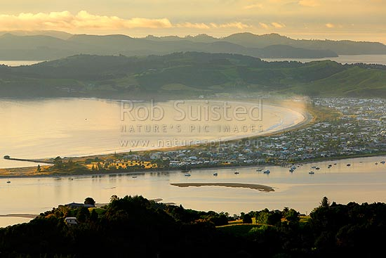 Omaha Beach, Little Omaha Bay and Whangateau Harbour entrance, with Tawharanui Peninsula and Kawau Island beyond, at dawn, Leigh, Rodney District, Auckland Region, New Zealand (NZ) stock photo.