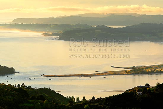 Whangateau Harbour entrance, Ti Point and Te Taumutu Point in Omaha Bay. Tawharanui Peninsula and Kawau Island beyond, at dawn, Leigh, Rodney District, Auckland Region, New Zealand (NZ) stock photo.