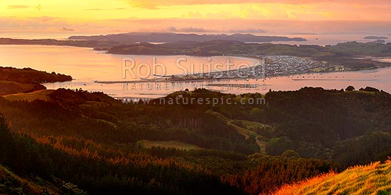 Omaha Beach and Whangateau Harbour, with Kawau Island beyond. Sunrise, Leigh, Rodney District, Auckland Region, New Zealand (NZ) stock photo.