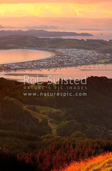 Omaha Beach and Whangateau Harbour. Hauraki Gulf and Kawau Island beyond. Dawn, Leigh, Rodney District, Auckland Region, New Zealand (NZ) stock photo.
