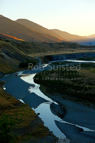 Sunrise in the Clarence River Valley above the Acheron confluence, near Bunkers Stream and Bush Gully, Molesworth Station, Marlborough District, Marlborough Region, New Zealand (NZ) stock photo.