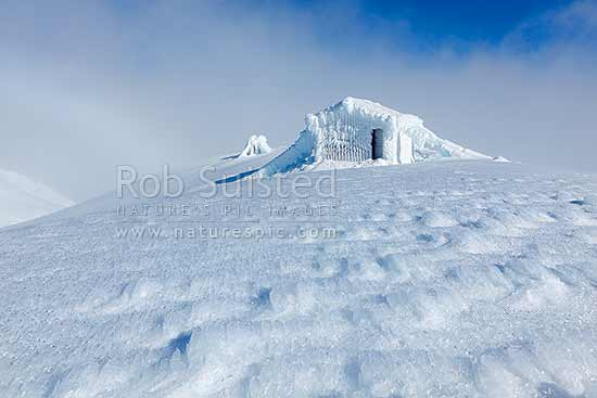 Syme Hut on Fantham's Peak (Panitahi) at 1962 m, on Mt Taranaki, encrusted with winter ice. Egmont National Park, Egmont National Park, Taranaki, Stratford District, Taranaki Region, New Zealand (NZ) stock photo.
