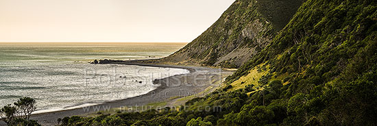 Moody south Wairarapa coastline at dusk. Windy Point and Mukamukaiti Stream centre. Southern Remutaka (Rimutaka) Ranges. Palliser Bay beyond. Panorama, Remutaka Forest Park, South Wairarapa District, Wellington Region, New Zealand (NZ) stock photo.