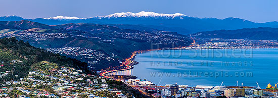 Wellington city with Tararua Ranges above. Looking along SH1/SH2 to the Hutt Valley beyond. Wadestown, Thorndon and Kaiwharawhara in foreground. Hutt City and Petone beyond. Winter dusk panorama, Wellington, Wellington City District, Wellington Region, New Zealand (NZ) stock photo.