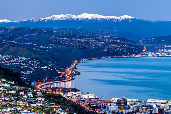 Wellington city with Tararua Ranges above. Looking along SH1/SH2 to the Hutt Valley beyond. Wadestown, Thorndon and Kaiwharawhara in foreground. Hutt City and Petone beyond. Winter dusk, Wellington, Wellington City District, Wellington Region, New Zealand (NZ) stock photo.
