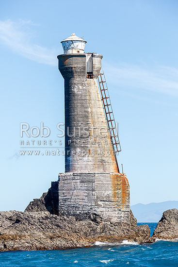 Karori Rock lighthouse, an historic 20 metre high tower completed in 1915, off Tongue Point, in Cook Strait, Wellington South Coast, Wellington City District, Wellington Region, New Zealand (NZ) stock photo.