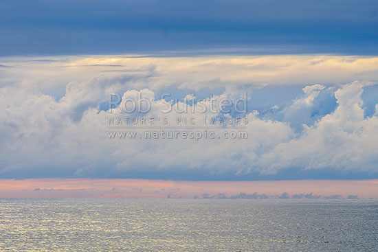 Clouds over the moody Tasman Sea. Seen from Bruce Bay on a calm evening, South Westland, Westland District, West Coast Region, New Zealand (NZ) stock photo.