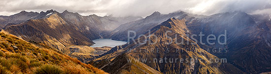 Lochnagar nestled in the Richardson Mountains, above the Shotover River headwaters. Pine Creek right. Shotover Conservation Area. Panorama, Shotover River, Queenstown Lakes District, Otago Region, New Zealand (NZ) stock photo.
