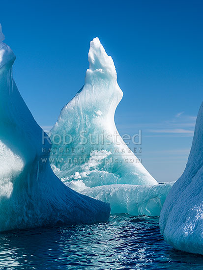 Blue iceberg with distinctive sculptured shape curving upwards. Terra Nova Bay, Ross Sea, Antarctica Region, Antarctica stock photo.