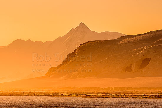 Mount Herschel (3335m) standing in the Admiralty Mountains, and above Cape Roget on the Adare Peninsula at twilight. First climbed in 1967 by Sir Ed Hillary. Victoria Land, Ross Sea, Antarctica Region, Antarctica stock photo.