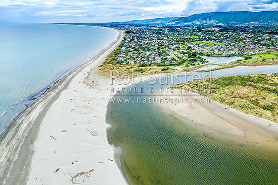 Waikanae Estuary, Waikanae River and Waimeha lagoons, with Waikanae Beach settlement and Tararua Forest Park beyond. Aerial view, Waikanae, Kapiti Coast District, Wellington Region, New Zealand (NZ) stock photo.