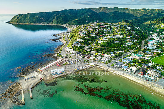 Karehana Bay, Plimmerton Boating Club, and Hongoeka Bay, with Te Rewarewa Point beyond. Airlie Road at right. Aerial view, Plimmerton, Porirua City District, Wellington Region, New Zealand (NZ) stock photo.