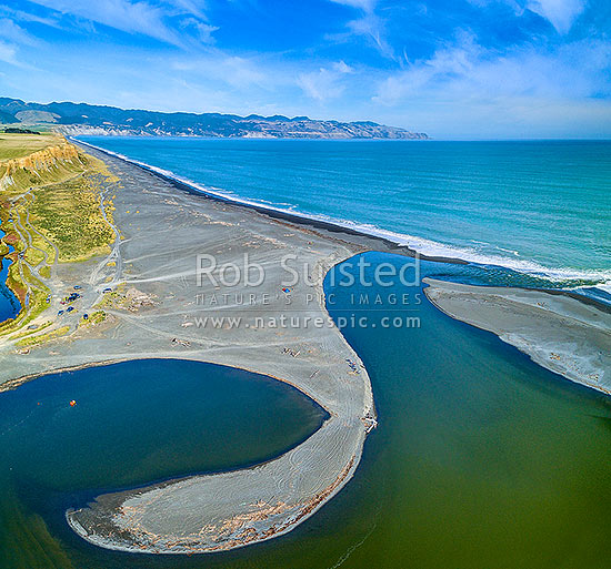 Lake Ferry (Onoke) and outlet into Palliser Bay. Looking along Whangaimoana Beach towards the Aorangi Ranges behind. Cape Palliser centre distance. Aerial view. Square format, Lake Ferry, South Wairarapa District, Wellington Region, New Zealand (NZ) stock photo.