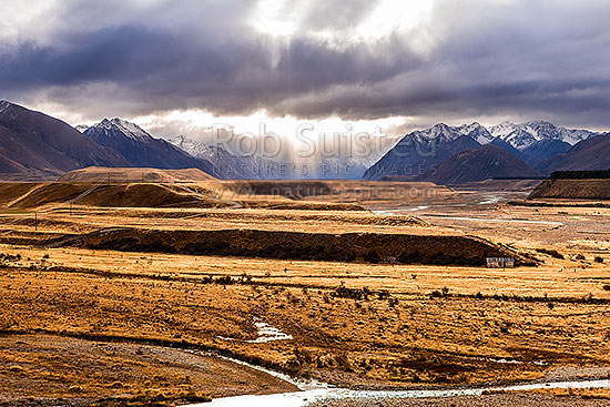 Ahuriri River Valley. Avon River (foreground) confluence with the Ahuriri River at right. Huxley Range (left), Barrier Range (right) and Ahuriri Conservation Park beyond, Ahuriri River, Waitaki District, Canterbury Region, New Zealand (NZ) stock photo.