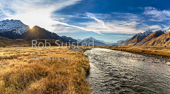 Tasman Valley sunset, with Aoraki Mt Cook (3754m) centre above clear mountain stream. Ben Ohau Range left, and Burnett Mountains right, Aoraki / Mount Cook National Park, MacKenzie District, Canterbury Region, New Zealand (NZ) stock photo.