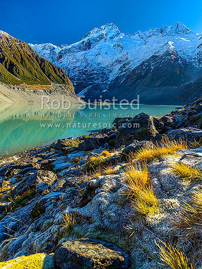 Mt Sefton (3151m left) and Footstool (2764m right) above the Mueller Glacier lake and valley. Southern Alps, Main Divide, Aoraki / Mount Cook National Park, MacKenzie District, Canterbury Region, New Zealand (NZ) stock photo.
