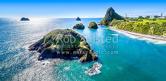 Sugarloaf Islands and Paritutu Rock (154m). Motuotamatea Is. (Snapper Rock) front, Motumahanga (Saddleback Rock) left, Whareumu (Lion Rock), Pararaki (Seagull Rock) and Mataora (Round Rock) centre. Aerial panorama, New Plymouth, New Plymouth District, Taranaki Region, New Zealand (NZ) stock photo.