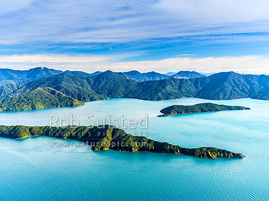 Long Island (Kokomohua marine reserve) and Motuara Island (right) before Ship Cove (Meretoto) and Mt Furneaux (centre). Cannibal Cove right. Queen Charlotte Sound aerial view, Marlborough Sounds, Marlborough District, Marlborough Region, New Zealand (NZ) stock photo.