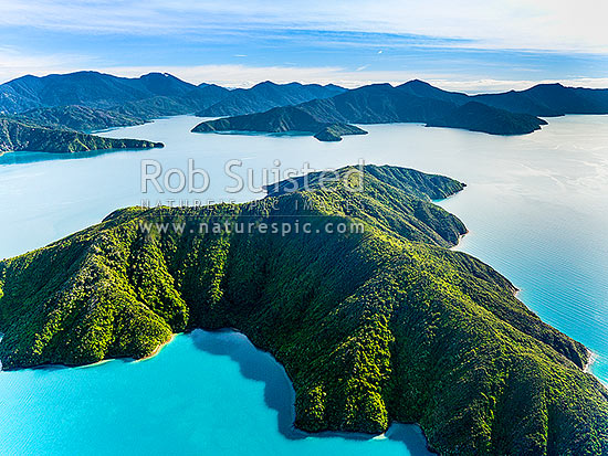 Blumine Island (Oruawairua) in Queen Charlotte Sound. Endeavour Inlet and Mount Stokes left, Resolution Bay and Mt Furneaux. Queen Charlotte Sound. Aerial view, Marlborough Sounds, Marlborough District, Marlborough Region, New Zealand (NZ) stock photo.