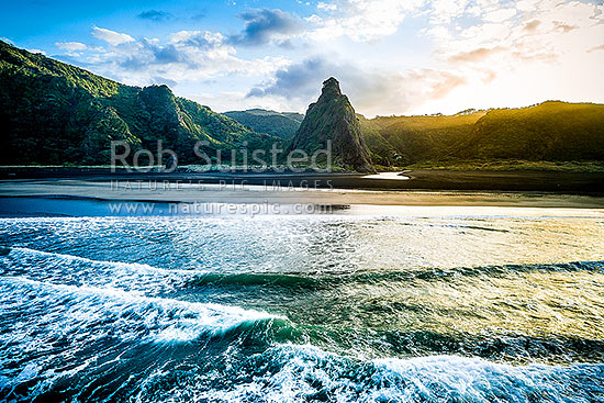 The Watchman tower above Karekare Beach and Stream, at sunrise. Waitakere Ranges, West Auckland, Karekare Beach, Waitakere City District, Auckland Region, New Zealand (NZ) stock photo.