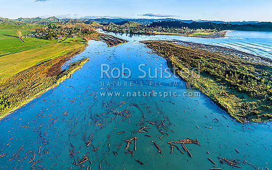 Tolaga Bay floods in June 2018 brought large amounts of forestry timber slash down Mangatokerau and Uawa Rivers to choke the estuary and cover beaches over a wide area. Aerial view, Tolaga Bay, Gisborne District, Gisborne Region, New Zealand (NZ) stock photo.