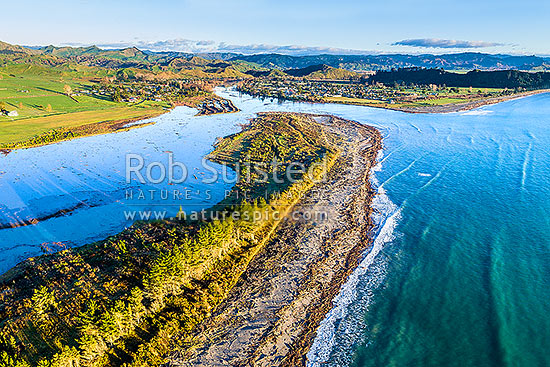 Tolaga Bay township, Uawa River mouth, Uawa River Estuary and Hauiti, seen from aerial view at dawn, Tolaga Bay, Gisborne District, Gisborne Region, New Zealand (NZ) stock photo.