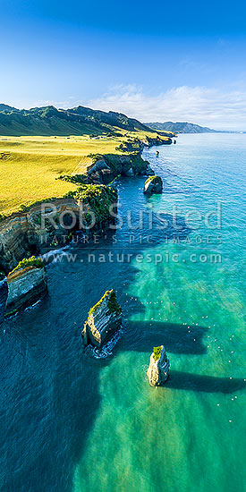 Tongaporutu Coast and rock stacks and birds. Three sisters rocks. Aerial view looking south past White Cliffs to Pariokariwa Point. North Taranaki. Vertical panorama, Tongaporutu, New Plymouth District, Taranaki Region, New Zealand (NZ) stock photo.