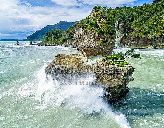 Waves crashing into rock stack at Motukiekie Rocks on Rapahoe Coast north of Greymouth. Paparoa Coast. Aerial view, Motukiekie, Grey District, West Coast Region, New Zealand (NZ) stock photo.