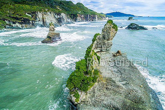 Rock stacks on the Paparoa Coast at Motukiekie Rocks. Point Elizabeth and Rapahoe Range beyond. Aerial view, Motukiekie, Grey District, West Coast Region, New Zealand (NZ) stock photo.
