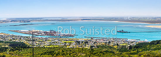Bluff Harbour with Bluff Port and township centre, and Tiwai wharf at right. View from Bluff Hill. Oreti Beach and New River Estuary distant left. Panorama, Bluff, Invercargill District, Southland Region, New Zealand (NZ) stock photo.