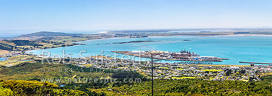 Bluff Harbour with Bluff Port and township centre. View from Bluff Hill. Oreti Beach and New River Estuary distant left. Panorama, Bluff, Invercargill District, Southland Region, New Zealand (NZ) stock photo.