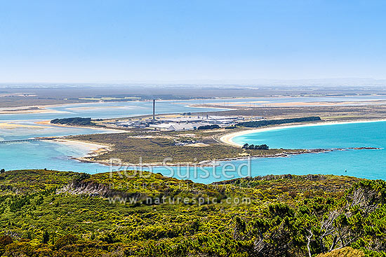 Tiwai Point aluminium smelter, with Awarua Bay behind, Bluff, Invercargill District, Southland Region, New Zealand (NZ) stock photo.