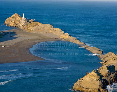 Overlooking Castlepoint Reef, Lagoon and lighthouse from Castle Rock. Last sunlight, Castlepoint, Masterton District, Wellington Region, New Zealand (NZ) stock photo.