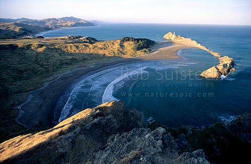 Overlooking Castlepoint, Lagoon and lighthouse from Castle Rock. Last sunlight, Castlepoint, Masterton District, Wellington Region, New Zealand (NZ) stock photo.