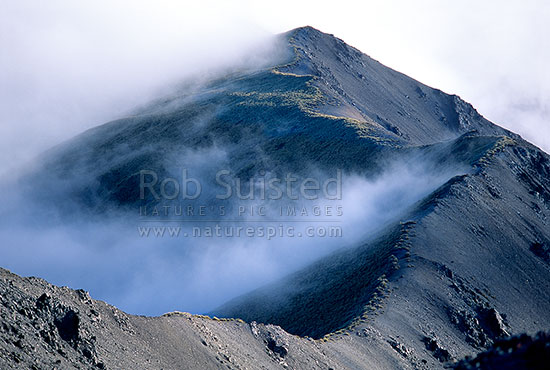 Mist building against the high ridge above Lower Farm Stream, Arthur's Pass National Park, Selwyn District, Canterbury Region, New Zealand (NZ) stock photo.