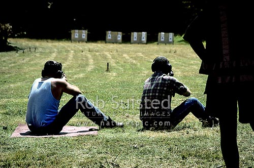 Target shooting - sitting position - 100 metre target, Wanganui, New Zealand (NZ) stock photo.