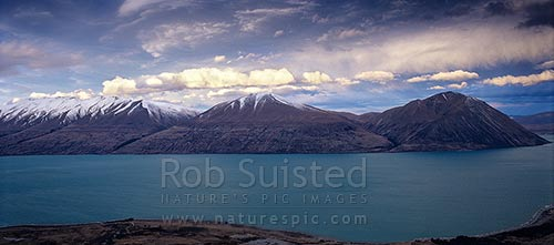 Dramatic clouds & lighting over the Ben Ohau Range & Lake Ohau, Lake Ohau, Twizel, MacKenzie District, Canterbury Region, New Zealand (NZ) stock photo.