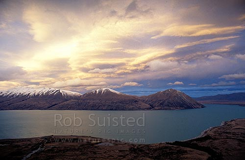 Dramatic clouds and lighting over the Ben Ohau Range and Lake Ohau, Lake Ohau, Twizel, MacKenzie District, Canterbury Region, New Zealand (NZ) stock photo.