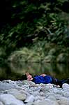 Sleeping fisherman near river